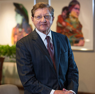 Laurence A. Schiffer, Chairman, CEO
